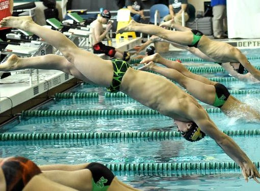 Sycamore's Carson Foster leads the charge into the pool for the final heat of the Boys 200 Yard IM at the 2019 GMC Swimming Championships, February 2, 2019.