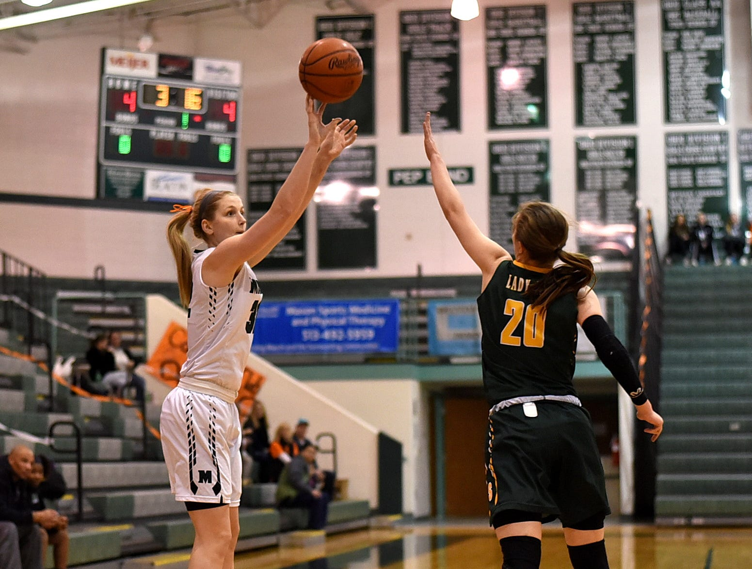 Mason's Sammie Puisis drains a three pointer for the Lady Comets in the 3rd Annual Live for Liz Fight For Cancer Free Kids Basketball Game, February1, 2019.