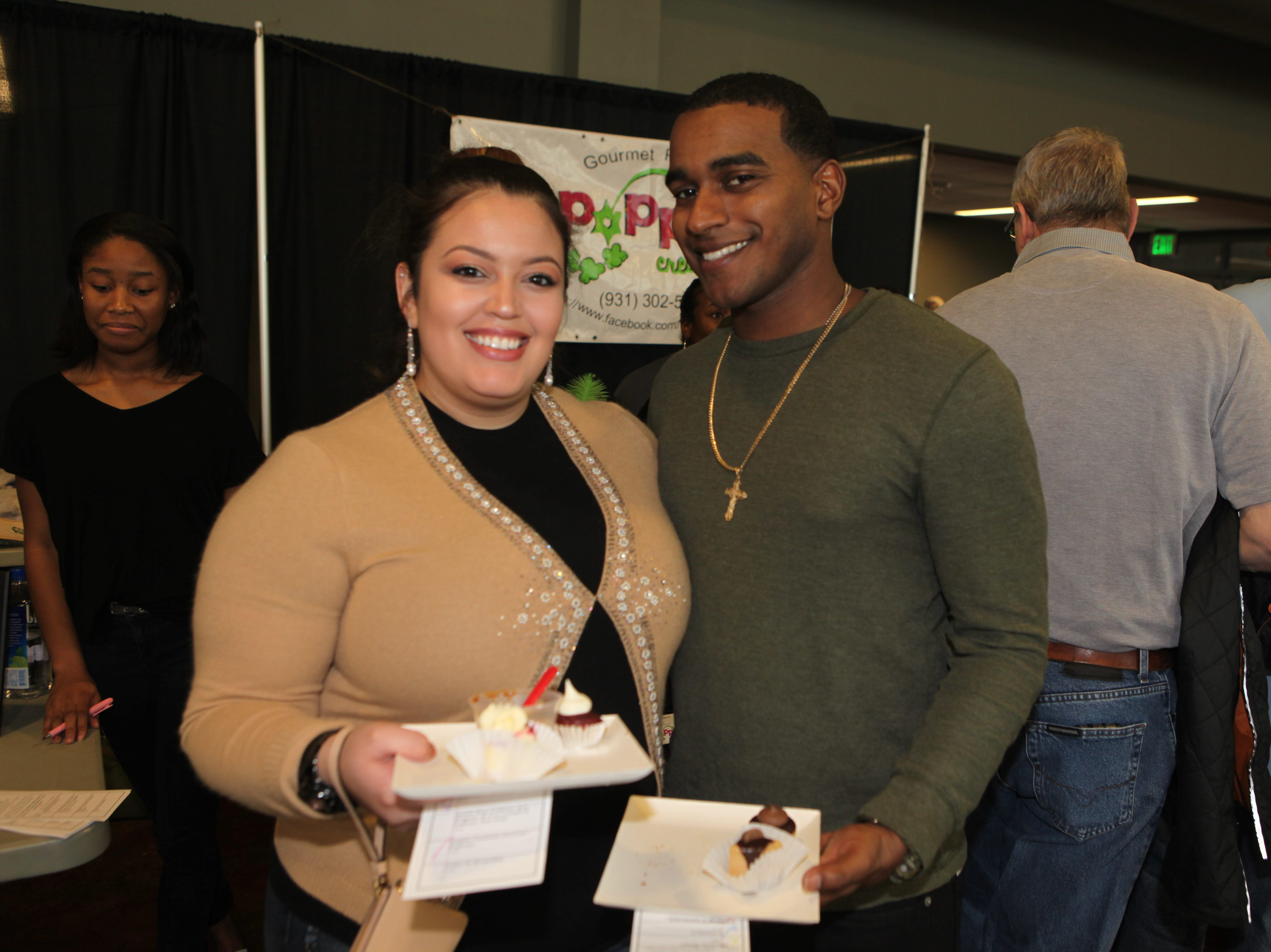Natalie Roman and Terrance Royer smile during the 7th Annual Chocolate Affair at Wilma Rudolph Event Center Saturday, February 2, 2019 . The sold-out event saw hundreds of guests enjoying chocolate creations from more than a dozen local and national vendors.