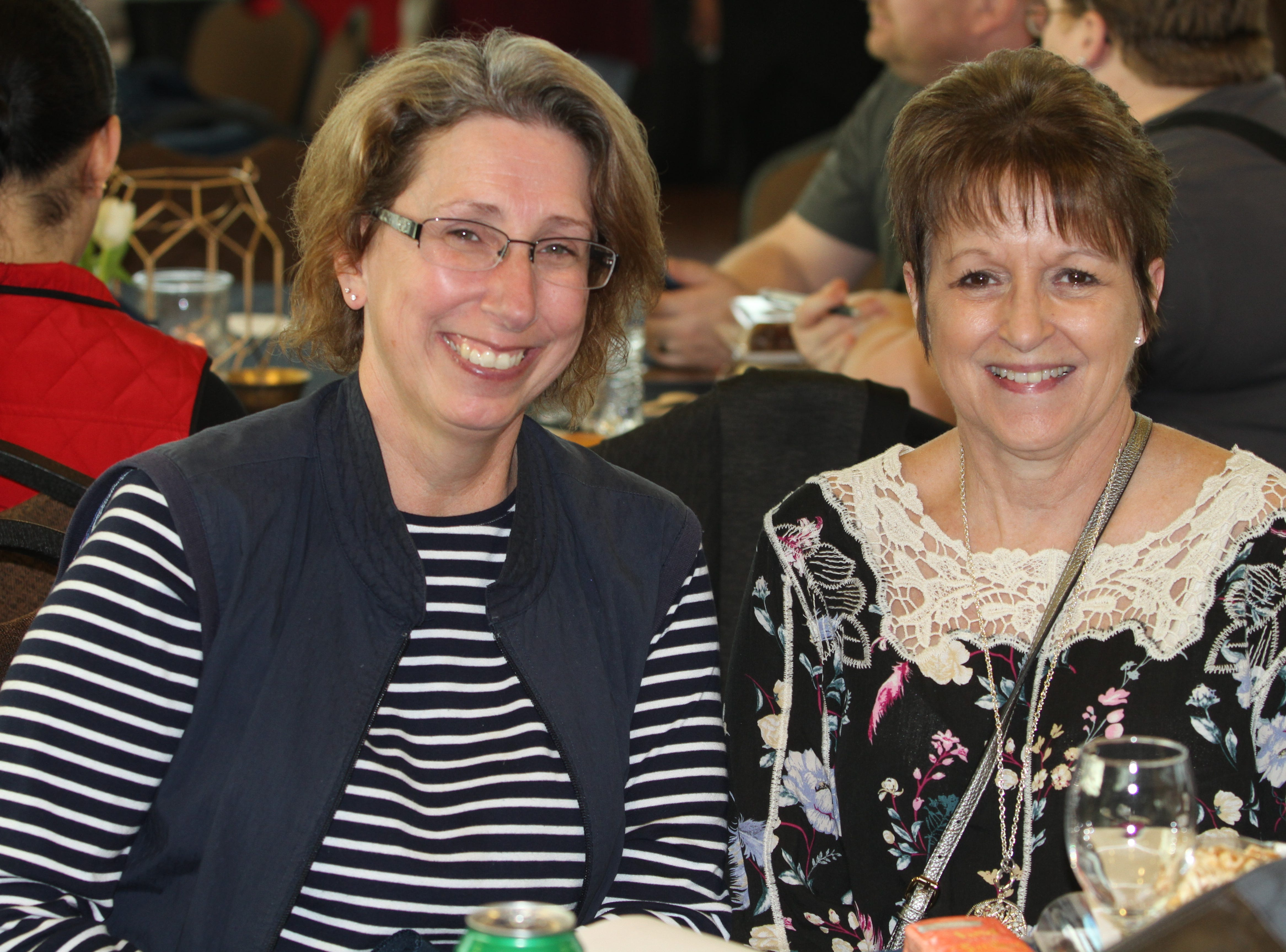 Maureen Hiemstra and Donna Richardson smile during the 7th Annual Chocolate Affair at Wilma Rudolph Event Center Saturday, February 2, 2019 . The sold-out event saw hundreds of guests enjoying chocolate creations from more than a dozen local and national vendors.