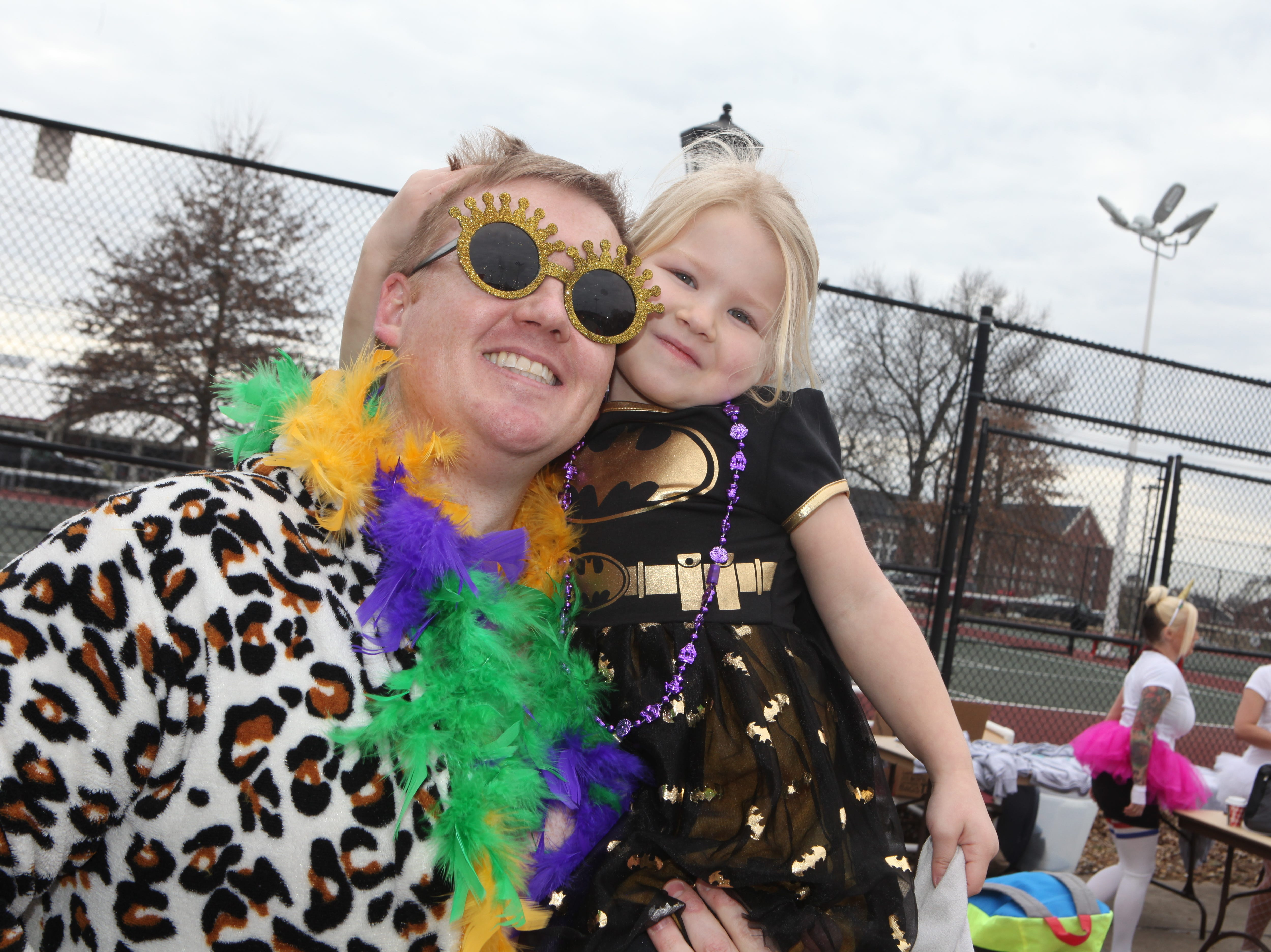 Costume contest winner Brad Forbis as King Baby and Ruby Kate Forbis as Bat Girl smile during the Special Olympics Polar Plunge at APSU on Saturday, Feb. 1, 2019. More than $10,000 was raised at this year's event.