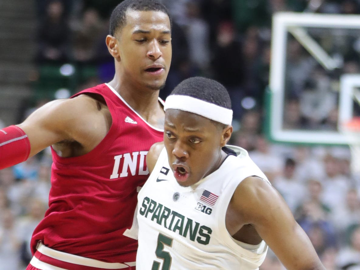 Michigan State guard Cassius Winston drives against Indiana guard Devonte Green during overtime of the 79-75 overtime loss to Indiana on Saturday, Feb. 2, 2019, in East Lansing.