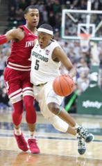 Cassius Winston drives against Indiana's Devonte Green on Feb. 2.