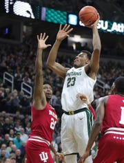 Michigan State forward Xavier Tillman scores against Indiana forward De'Ron Davis during the first half Saturday, Feb. 2, 2019 at the Breslin Center in East Lansing.