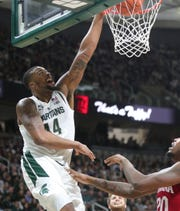 Michigan State forward Nick Ward scores against Indiana forward De'Ron Davis during the second half of the 79-75 overtime loss to Indiana on Saturday, Feb. 2, 2019, in East Lansing.