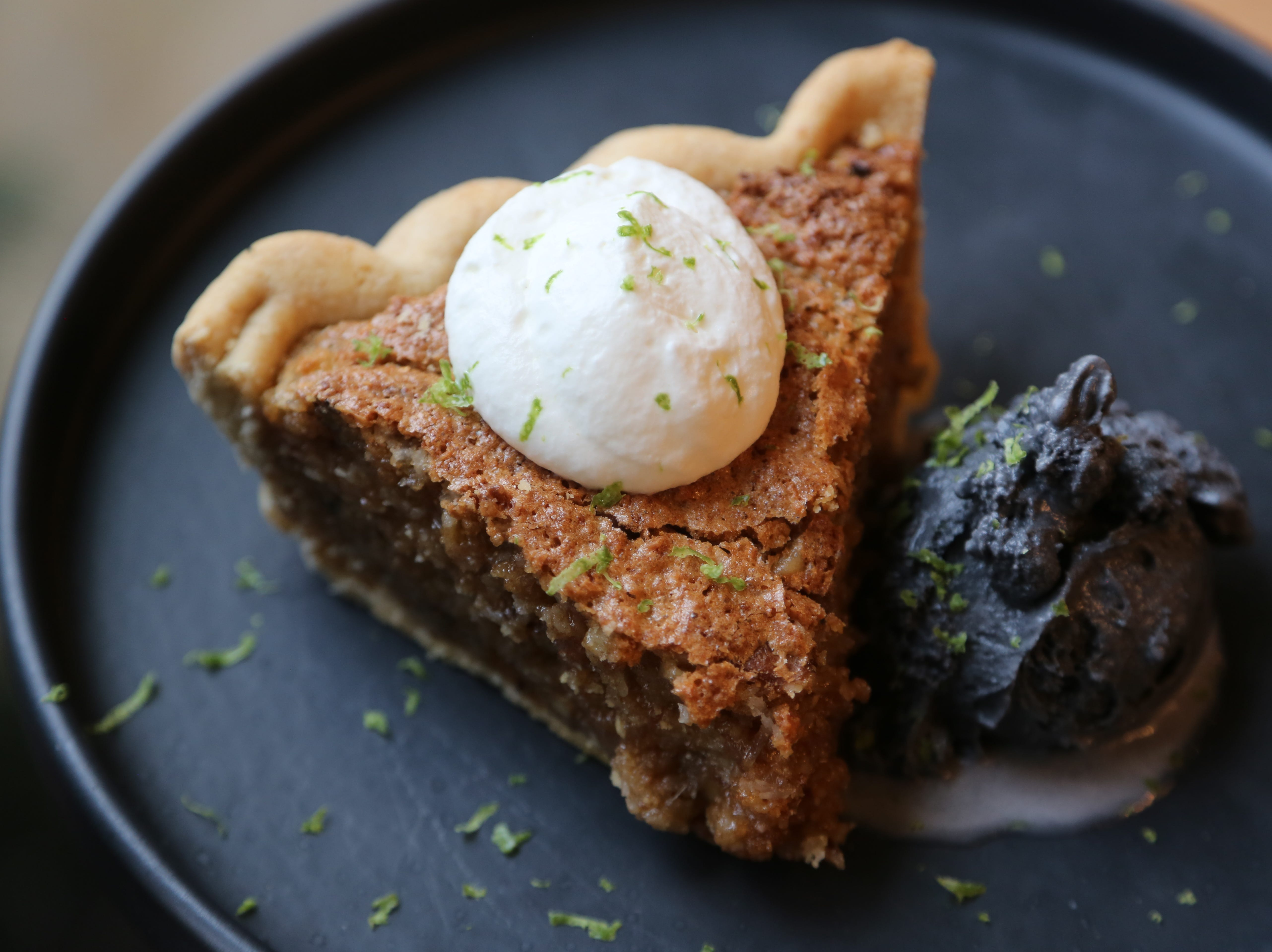 Coconut and walnut pie a la mode with lime-flavored charcoal ice cream from Hazel, Ravines & Downtown in Birmingham.