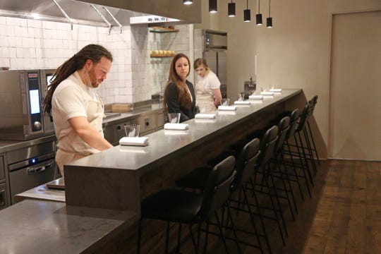 Albena chef Garrett Lipar, left, general manager Tiffany Henderson and sous chef Emma Taylor inside the eight-seat tasting counter restaurant at Detroit's Siren Hotel.