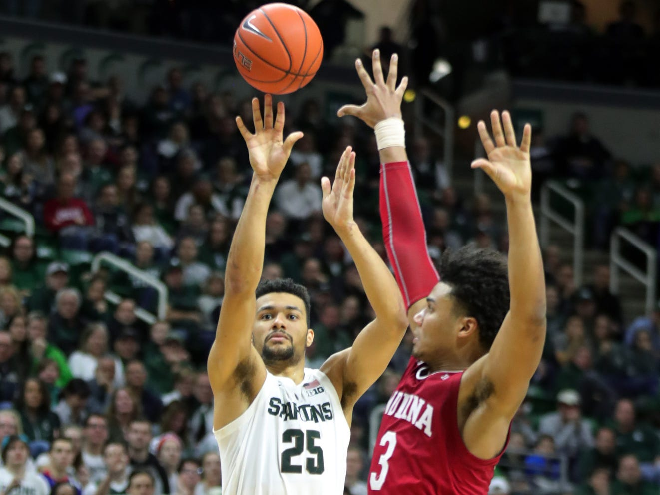 Michigan State forward Kenny Goins scores against Indiana forward Justin Smith during the second half of the 79-75 overtime loss to Indiana on Saturday, Feb. 2, 2019, in East Lansing.