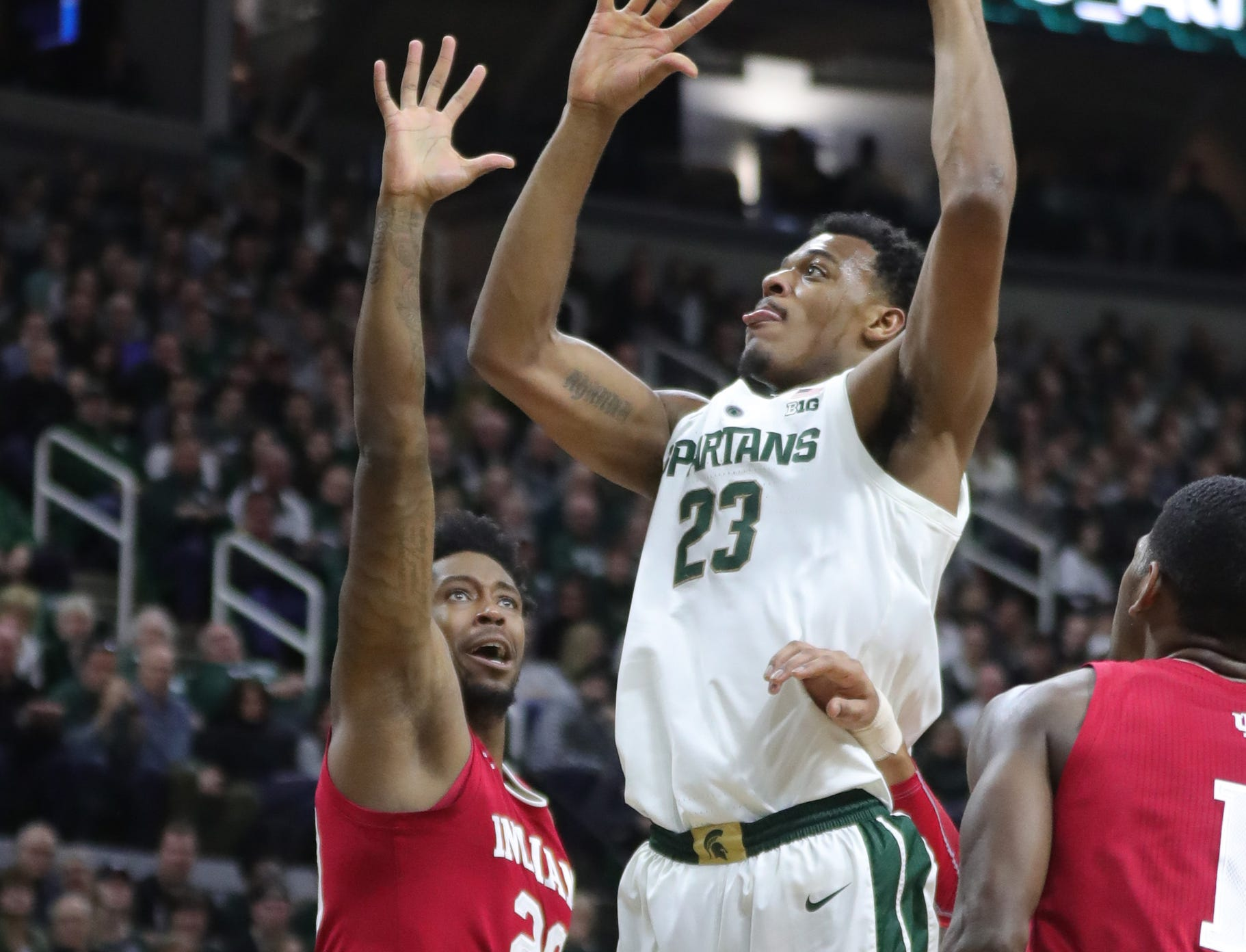 Michigan State forward Xavier Tillman scores against Indiana forward De'Ron Davis during first half action Saturday, Feb. 2, 2019 at the Breslin Center in East Lansing, Mich.