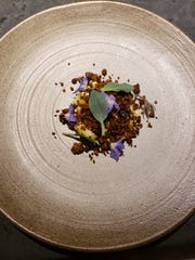 Corn pudding with pickled blueberries, starflower and oyster leaf at Albena in Detroit.