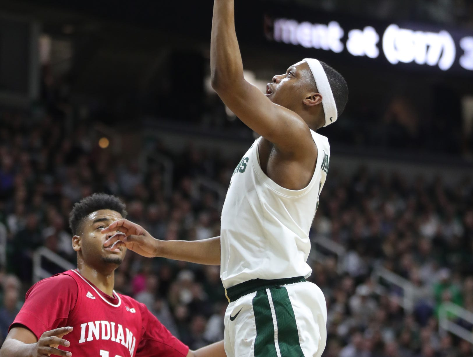 Michigan State guard Cassius Winston scores against Indiana forward Juwan Morgan during first half action Saturday, Feb. 2, 2019 at the Breslin Center in East Lansing, Mich.