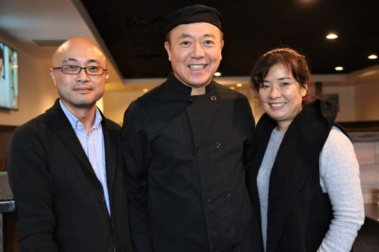 Soora general manager Chris Chung, left, chef-owner Y.K. Choi and his wife and co-owner Grace Choi.