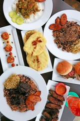 A spread of fare from Norma G's, a full-service Caribbean restaurant in Detroit's Jefferson-Chalmers neighborhood.