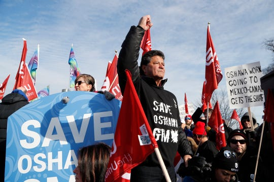 Jerry Dias, the national president for Unifor, the national union representing auto workers, addresses a rally within view of General Motors headquarters, Friday, Jan. 11, 2019, in Windsor, Ont. Workers were protesting the closing of the Oshawa assembly plant.