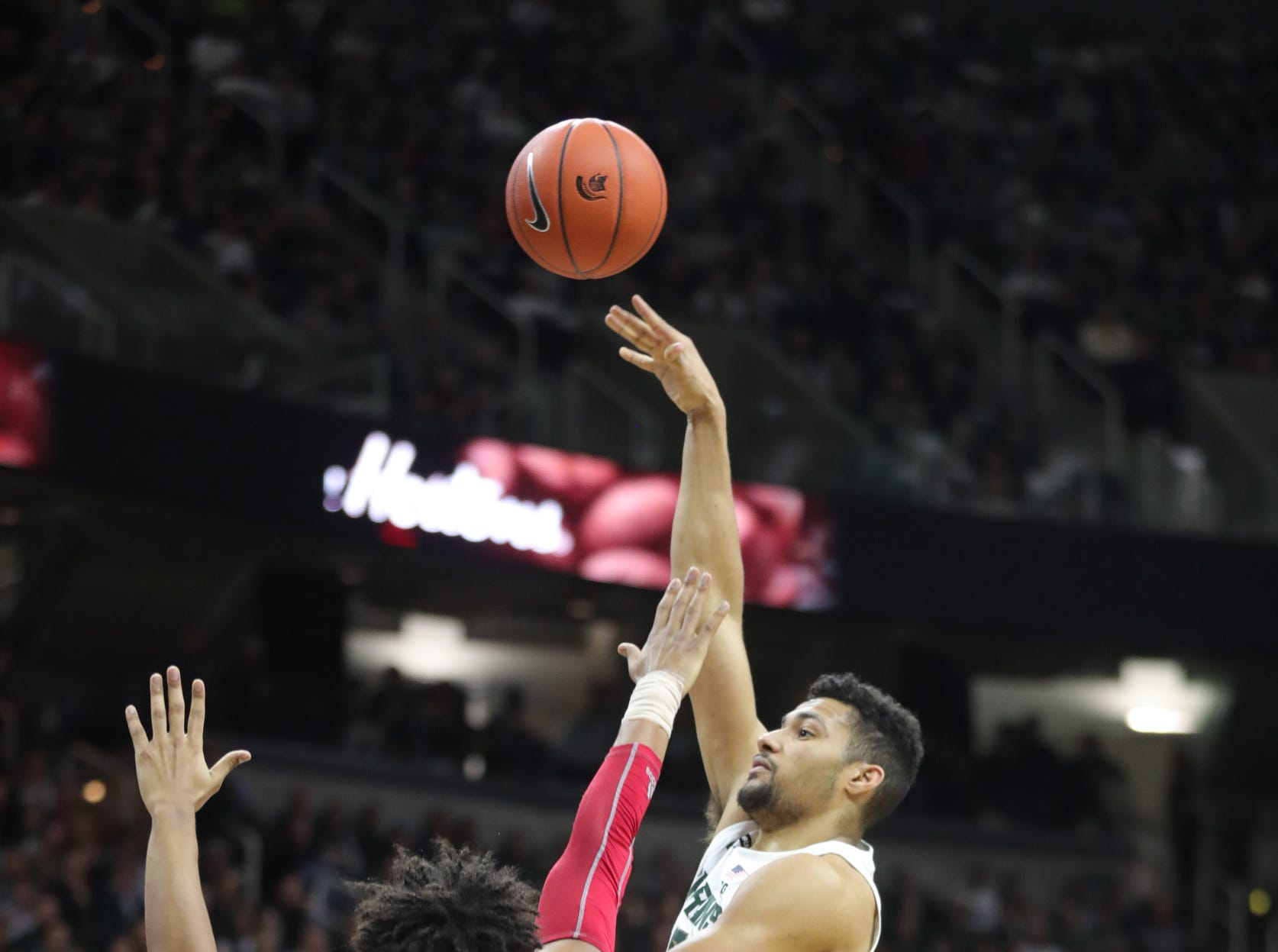 Michigan State forward Kenny Goins shoots against Indiana forward Justin Smith during first half action Saturday, Feb. 2, 2019 at the Breslin Center in East Lansing, Mich.