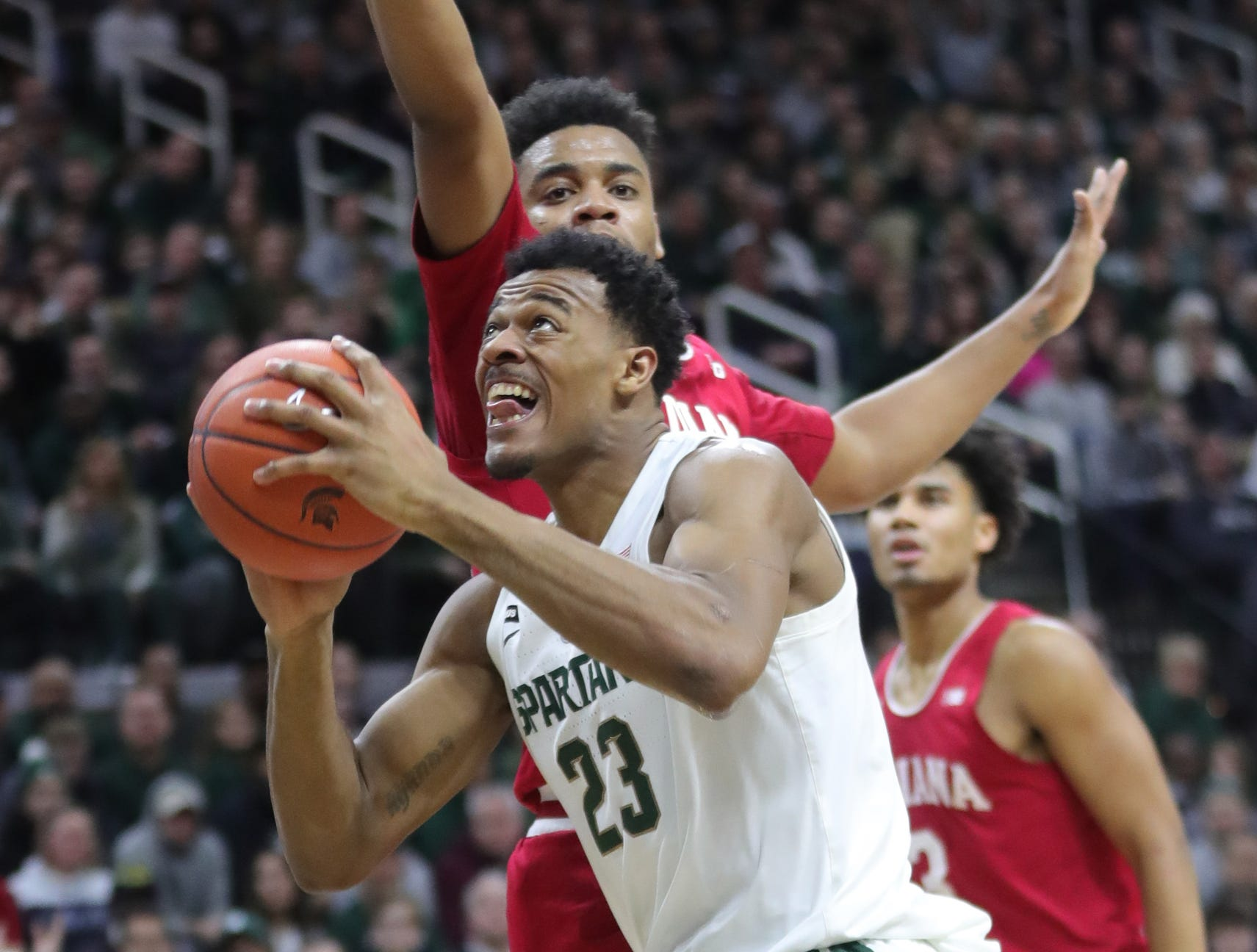 Michigan State forward Xavier Tillman scores against Indiana forward Juwan Morgan during first half action Saturday, Feb. 2, 2019 at the Breslin Center in East Lansing, Mich.