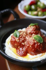 Andrew Carmellini's lamb meatballs are served with airy whipped goat cheese and tomato sauce at San Morello in Detroit.
