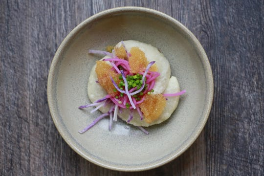 Glutinous dumplings are filled with beef, fried in tallow and topped with whitefish roe and pickled radish at Marrow in Detroit's West Village neighborhood.