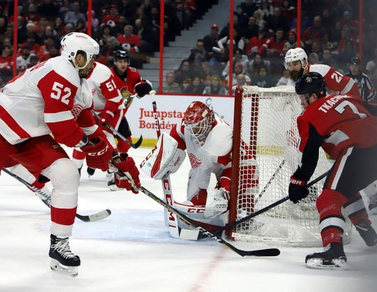 Red Wings defenseman Jonathan Ericsson defends as goaltender Jonathan Bernier blocks a wraparound attempt by the Senators' Brady Tkachuk during the second period of the Red Wings' 2-0 win on Saturday, Feb. 2, 2019, in Ottawa.