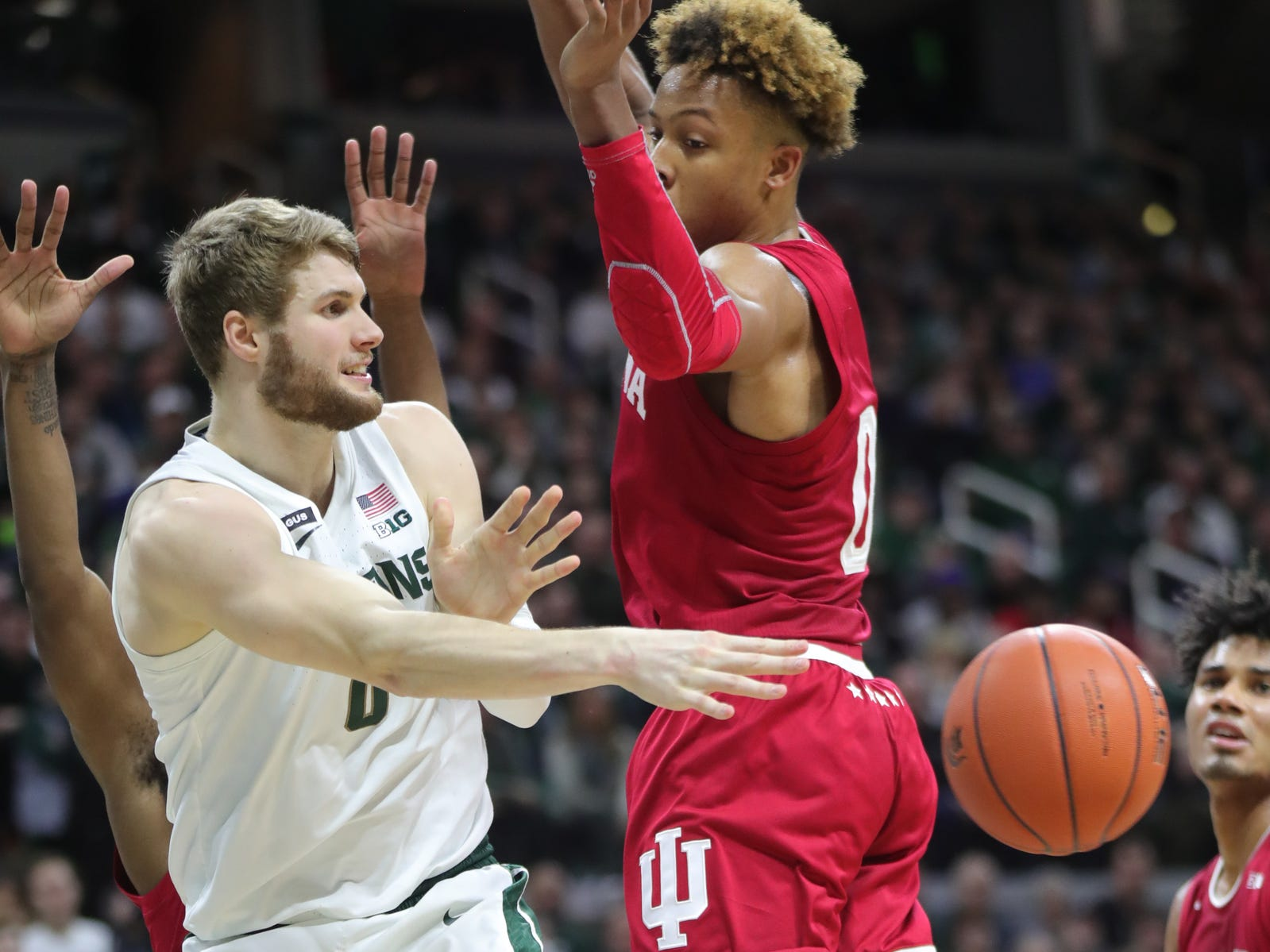 Michigan State's Kyle Ahrens passes around Indiana's Romeo Langford during the first half Feb. 2, 2019 at the Breslin Center in East Lansing.