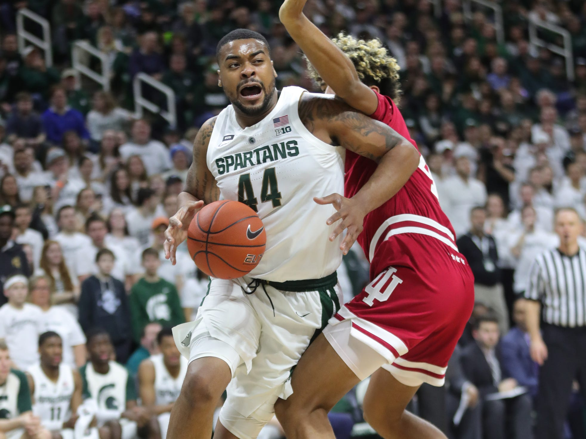 Michigan State forward Nick Ward drives against Indiana forward Jake Forrester during the second half of the 79-75 overtime loss to Indiana on Saturday, Feb. 2, 2019, in East Lansing.
