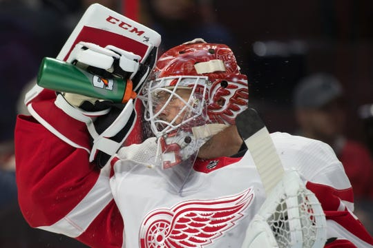 Red Wings goalie Jonathan Bernier waters down prior to the start of the second period of the Red Wings' 2-0 win on Saturday, Feb. 2, 2019, in Ottawa.