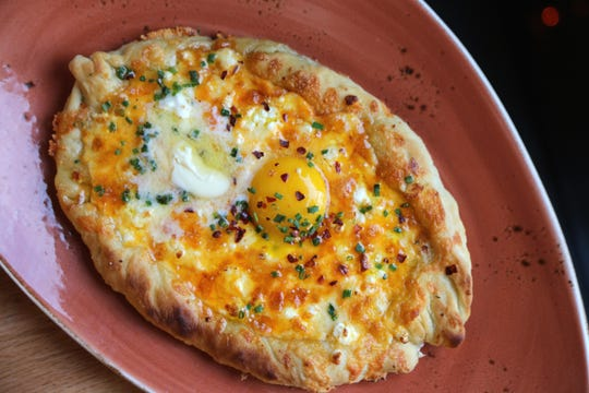 Georgian cheese bread (Adjarian khachapuri) from Hazel, Ravines & Downtown in Birmingham.