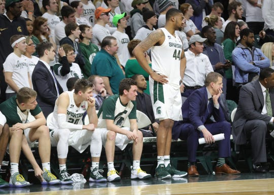 Michigan State forward Nick Ward stands while on the bench and watches the final seconds of the 79-75 overtime loss to Indiana on Saturday, Feb. 2, 2019, in East Lansing.