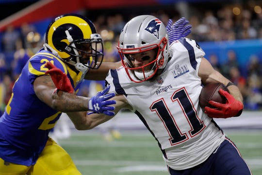 Los Angeles Rams' Aqib Talib, left, chases New England Patriots' Julian Edelman during the first quarter of Super Bowl LIII, Sunday, Feb. 3, 2019, in Atlanta.