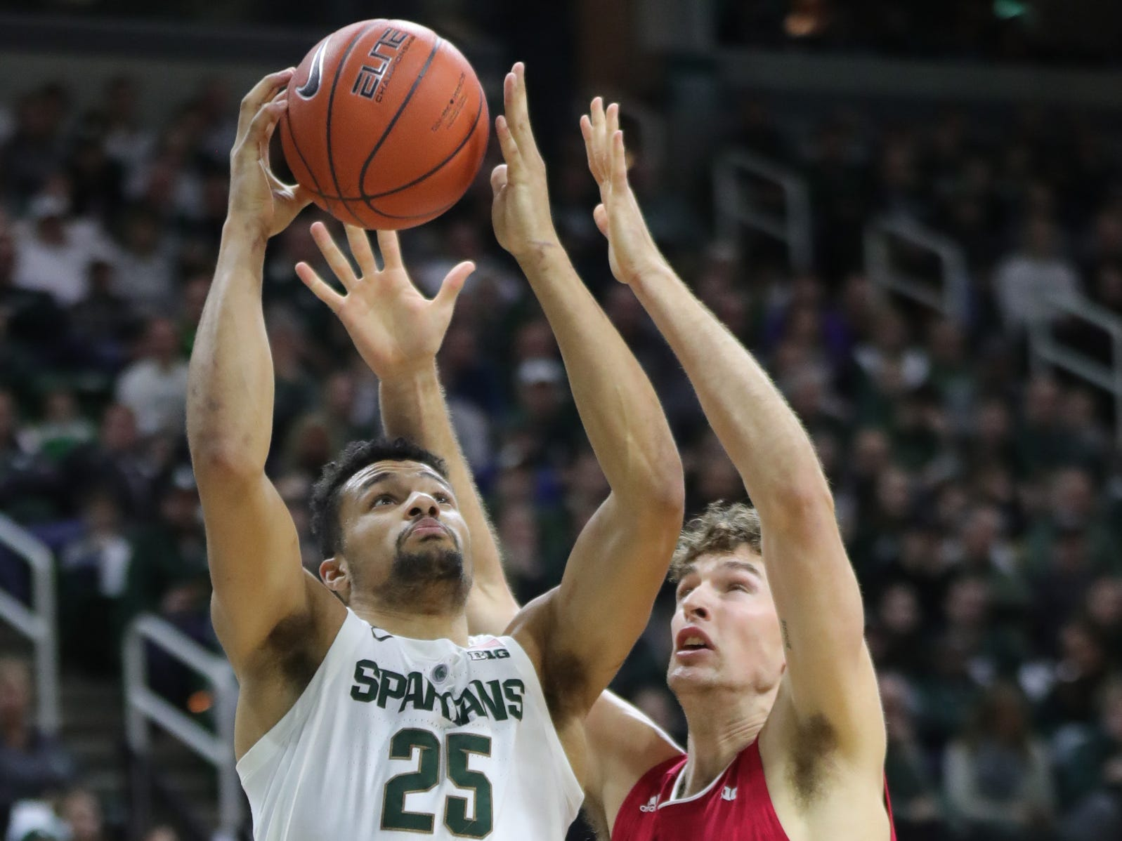 Michigan State forward Kenny Goins drives against Indiana forward Evan Fitzner during the first half of the 79-75 overtime loss to Indiana on Saturday, Feb. 2, 2019, in East Lansing.