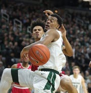 Michigan State forward Xavier Tillman has his shot blocked by Indiana forward Justin Smith during first half action Saturday, Feb. 2, 2019 at the Breslin Center in East Lansing, Mich.