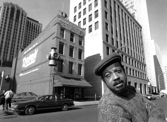 Bert Dearing stands in front of the former location of Bert's, on Jefferson between Shelby and Griswold, in 1987.