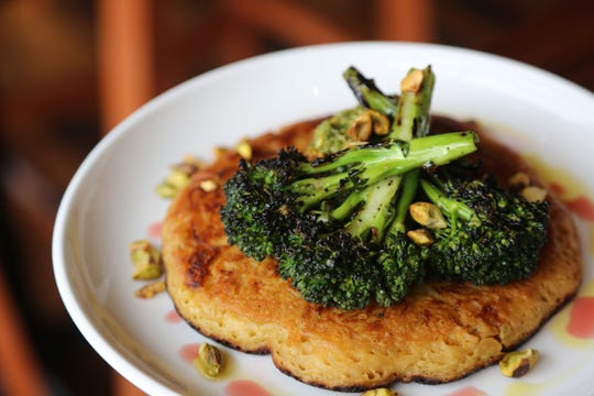 Farinata (chickpea-flour pancake) with rapini salsa verde, charred broccolini and pistachios ($12) from SheWolf Pastificio & Bar in Detroit's Cass Corridor/Midtown neighborhood.