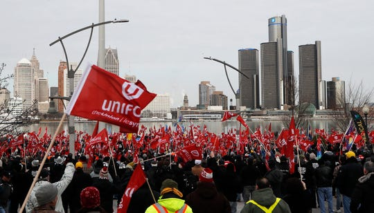 Supporters for Unifor, the national union representing auto workers, attend a rally within view of General Motors headquarters, background on Friday, Jan. 11, 2019, in Windsor, Ont. Workers were protesting the closing of the Oshawa assembly plant.
