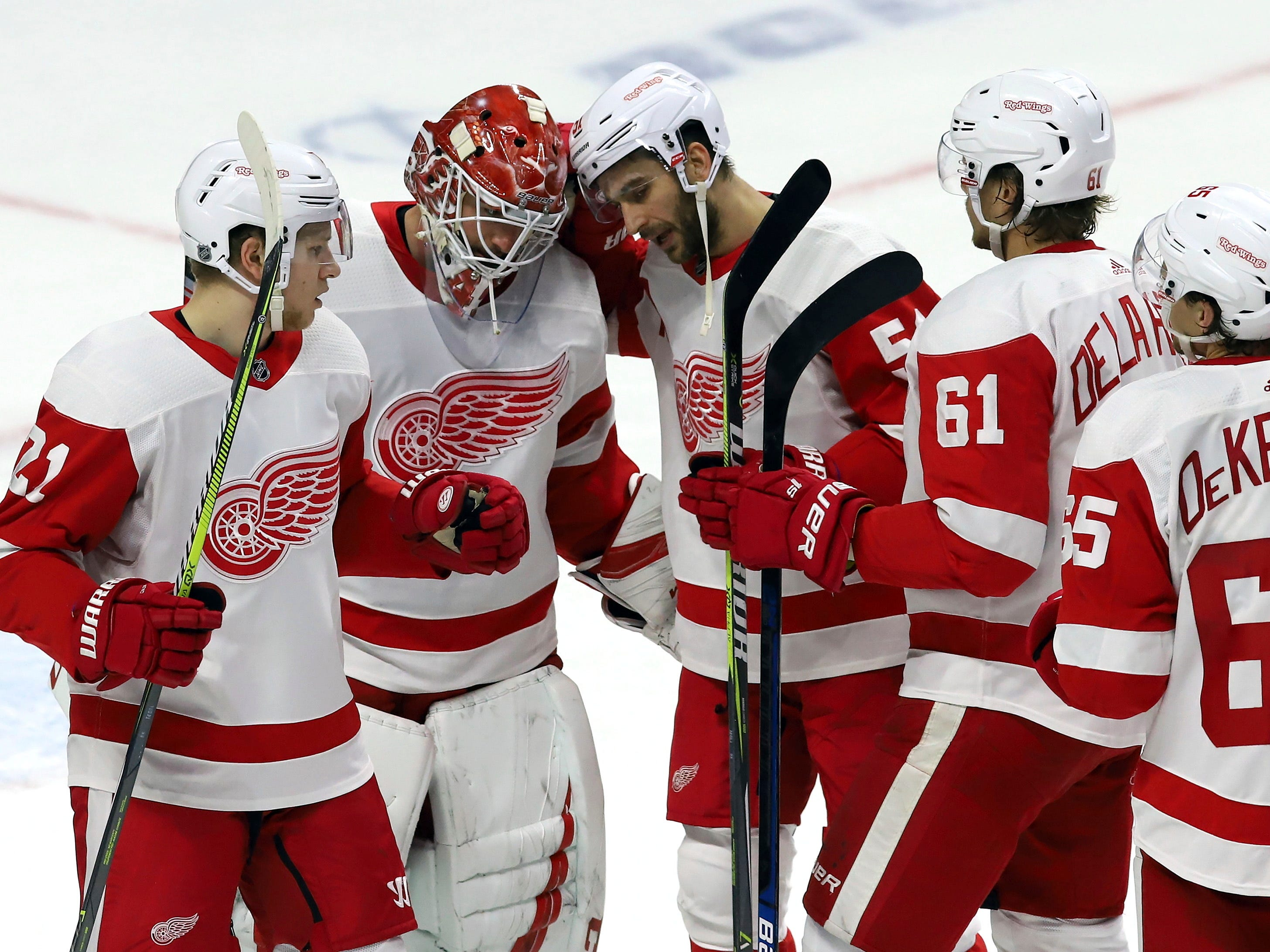 Detroit Red Wings goaltender Jonathan Bernier (45) celebrates with teammates Denis Cholowski (21), Frans Nielsen (51) Jacob de la Rose (61) and Danny DeKeyser (65) after defeating the Ottawa Senators.