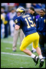 Scot Loeffler was a quarterback at Michigan from 1993-96 and later was an assistant coach for the Wolverines.