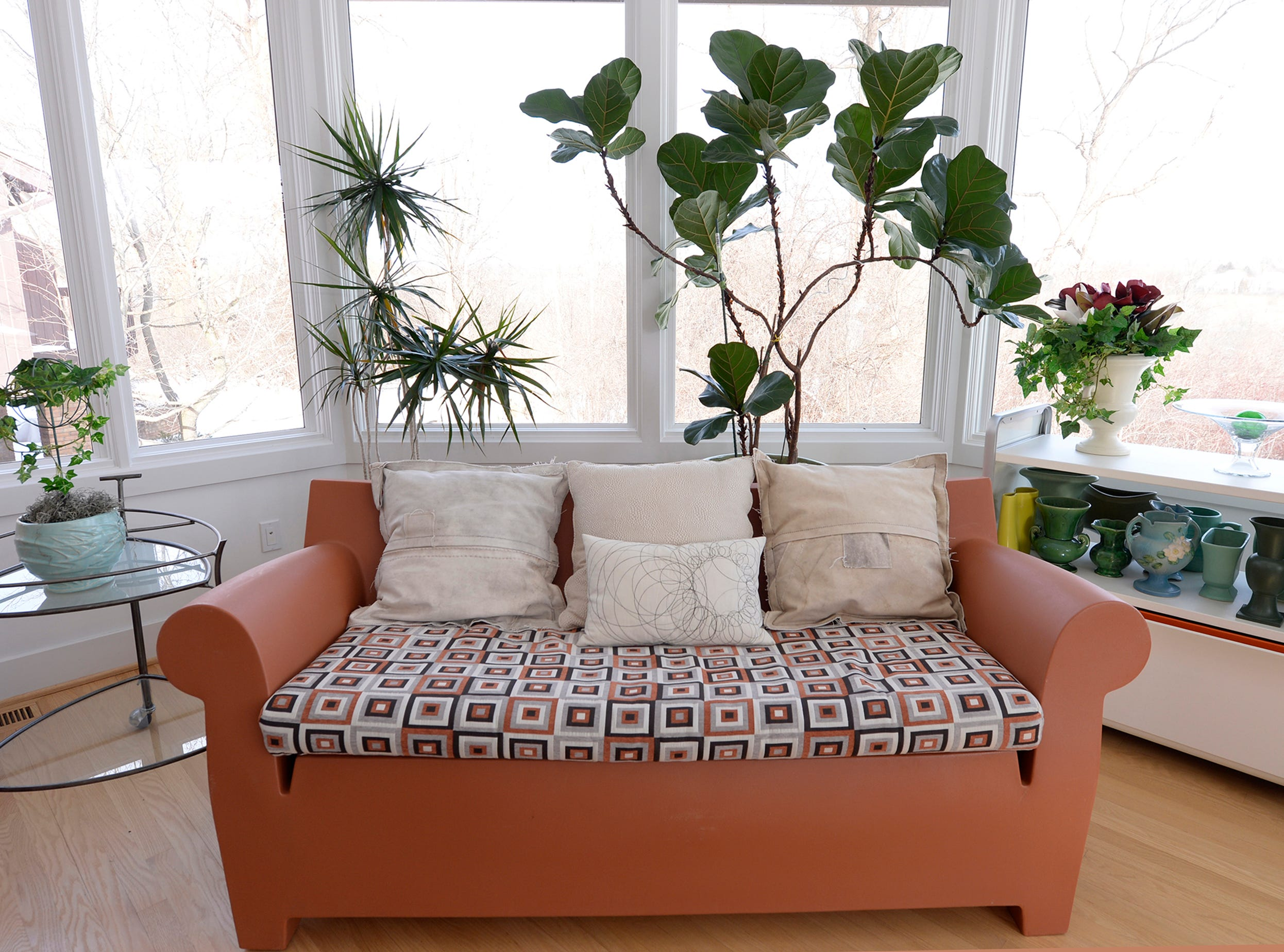 Detail shot of a sofa inside the conservatory room.