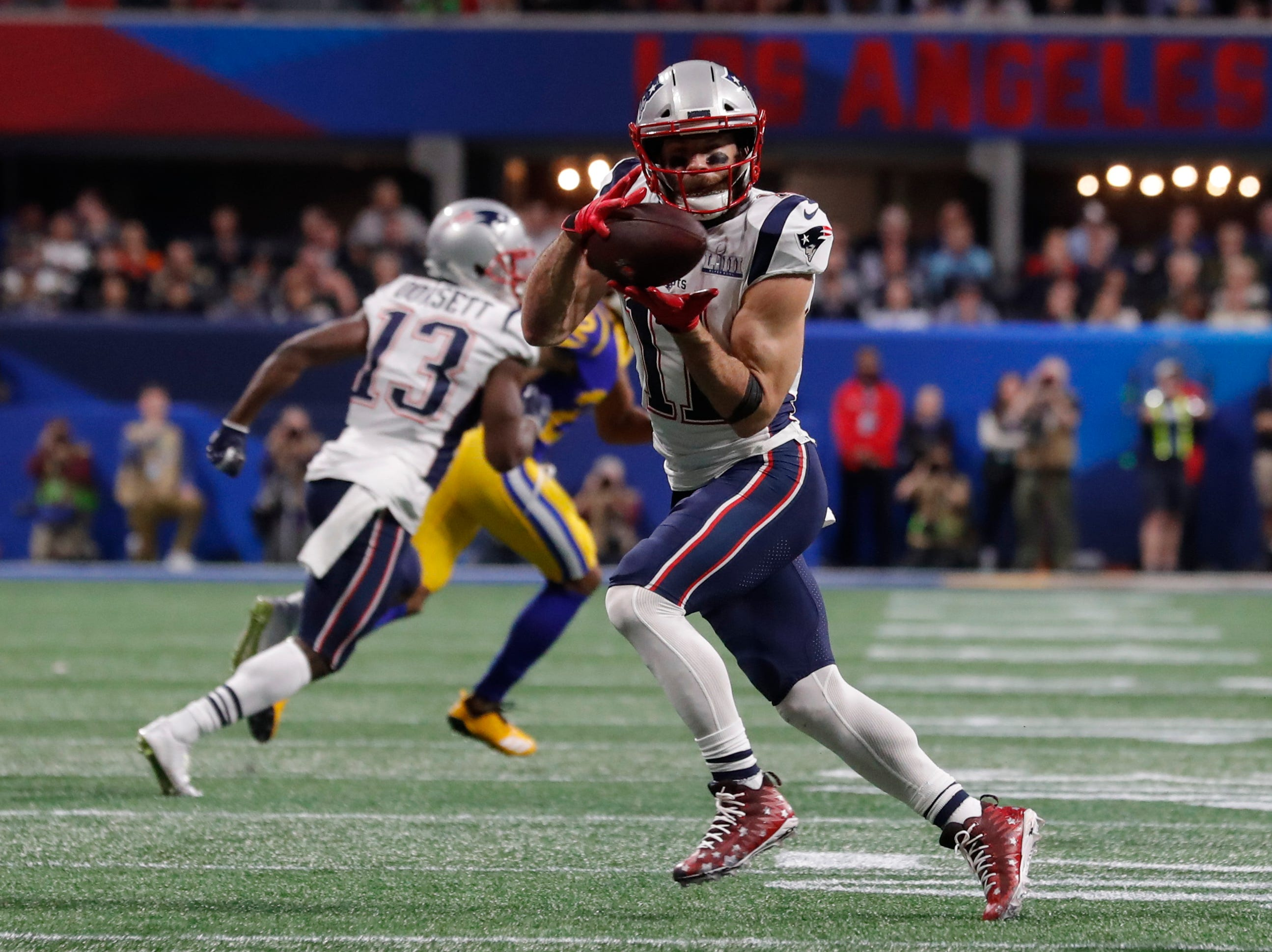 New England Patriots' Julian Edelman (11) makes a catch during the first half.