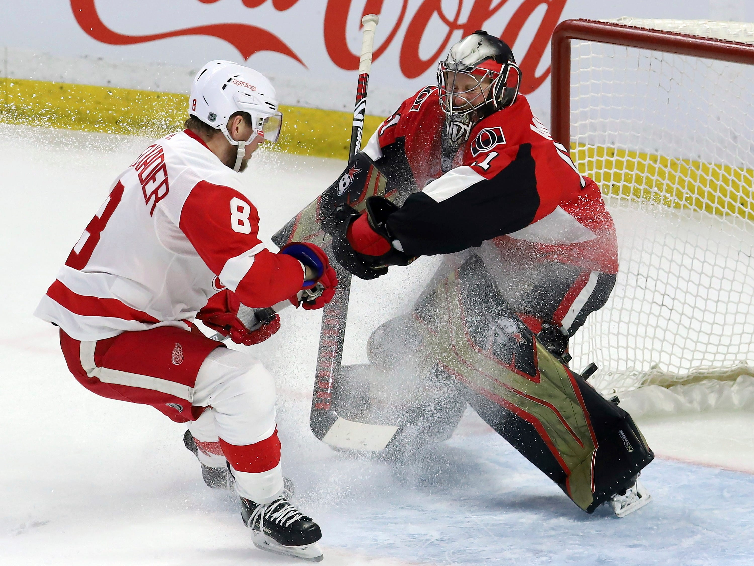 Ottawa Senators' Craig Anderson (41) makes a save on a breakaway from Detroit Red Wings' Justin Abdelkader (8) during the third period.