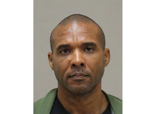 In this photo provided by the Kent County Michigan Sheriff's office, Cedric Marks is pictured in a booking photo.