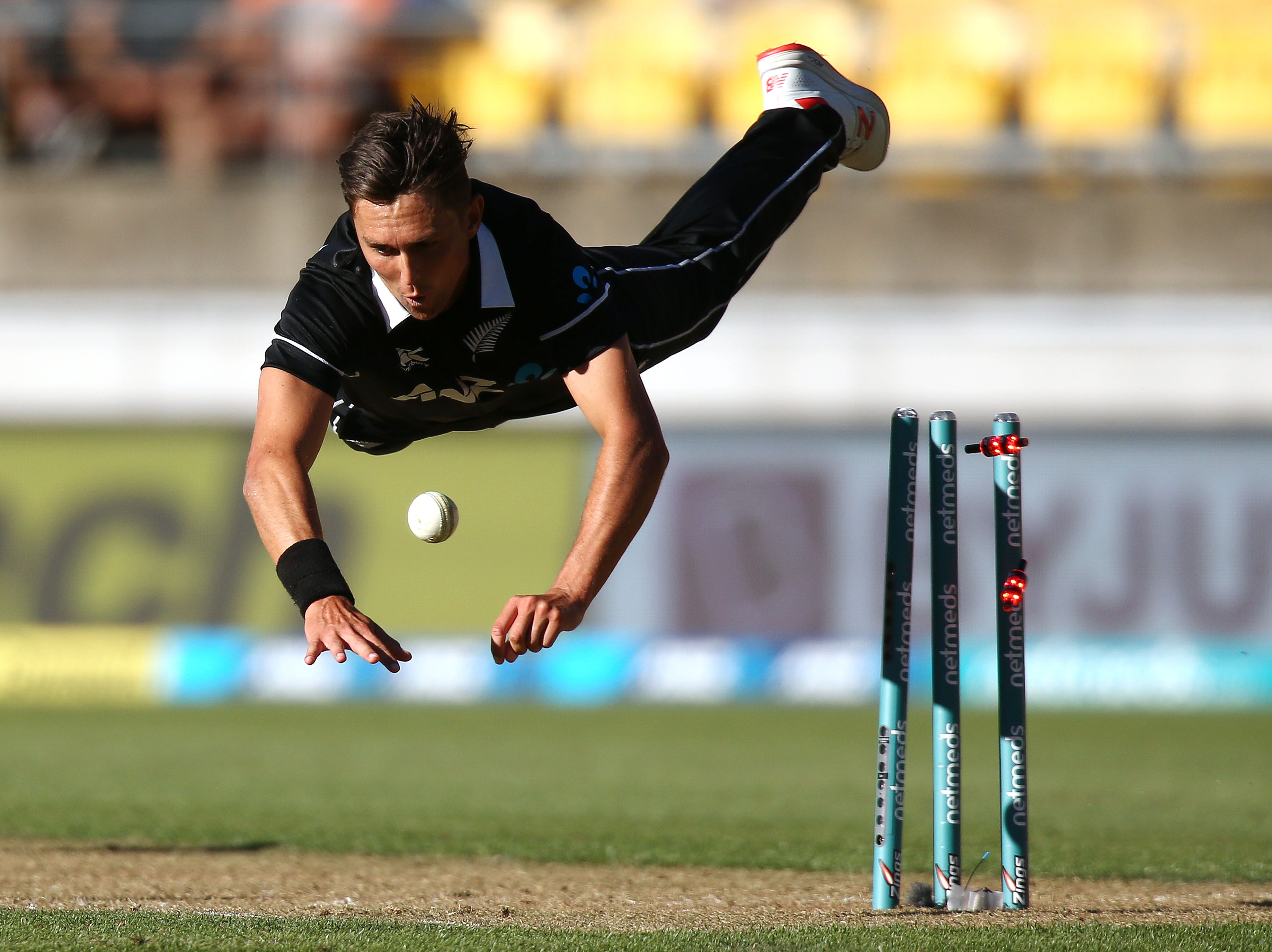 Trent Boult of New Zealand takes the wicket of Yuzvendra Chahal of India during game five in the One Day International series between New Zealand and India at Westpac Stadium on February 03, 2019 in Wellington, New Zealand.