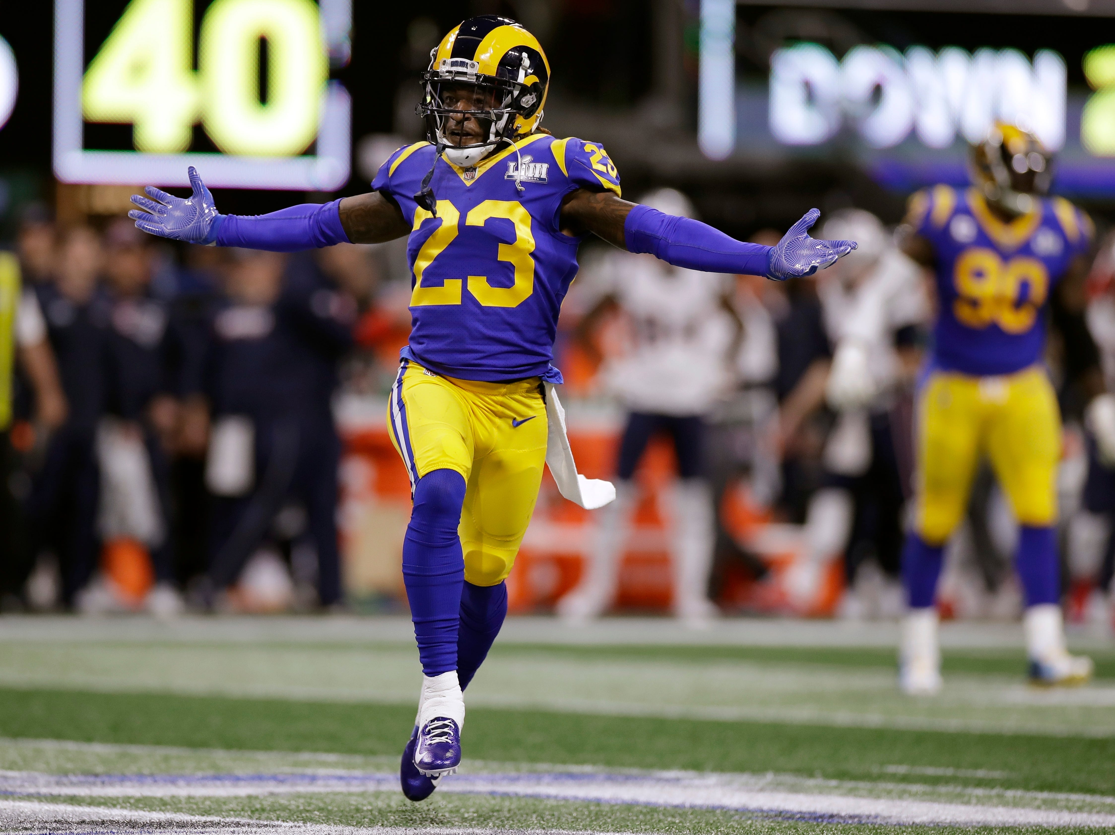 Los Angeles Rams' Nickell Robey-Coleman celebrates after an interception by teammate Cory Littleton (58) during the first half.