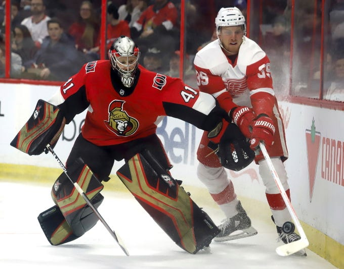 Ottawa Senators goaltender Craig Anderson (41) battles for the puck behind his net against Detroit Red Wings' Anthony Mantha (39) during first-period NHL hockey game action in Ottawa, Saturday, Feb. 2, 2019. (Fred Chartrand/The Canadian Press via AP)