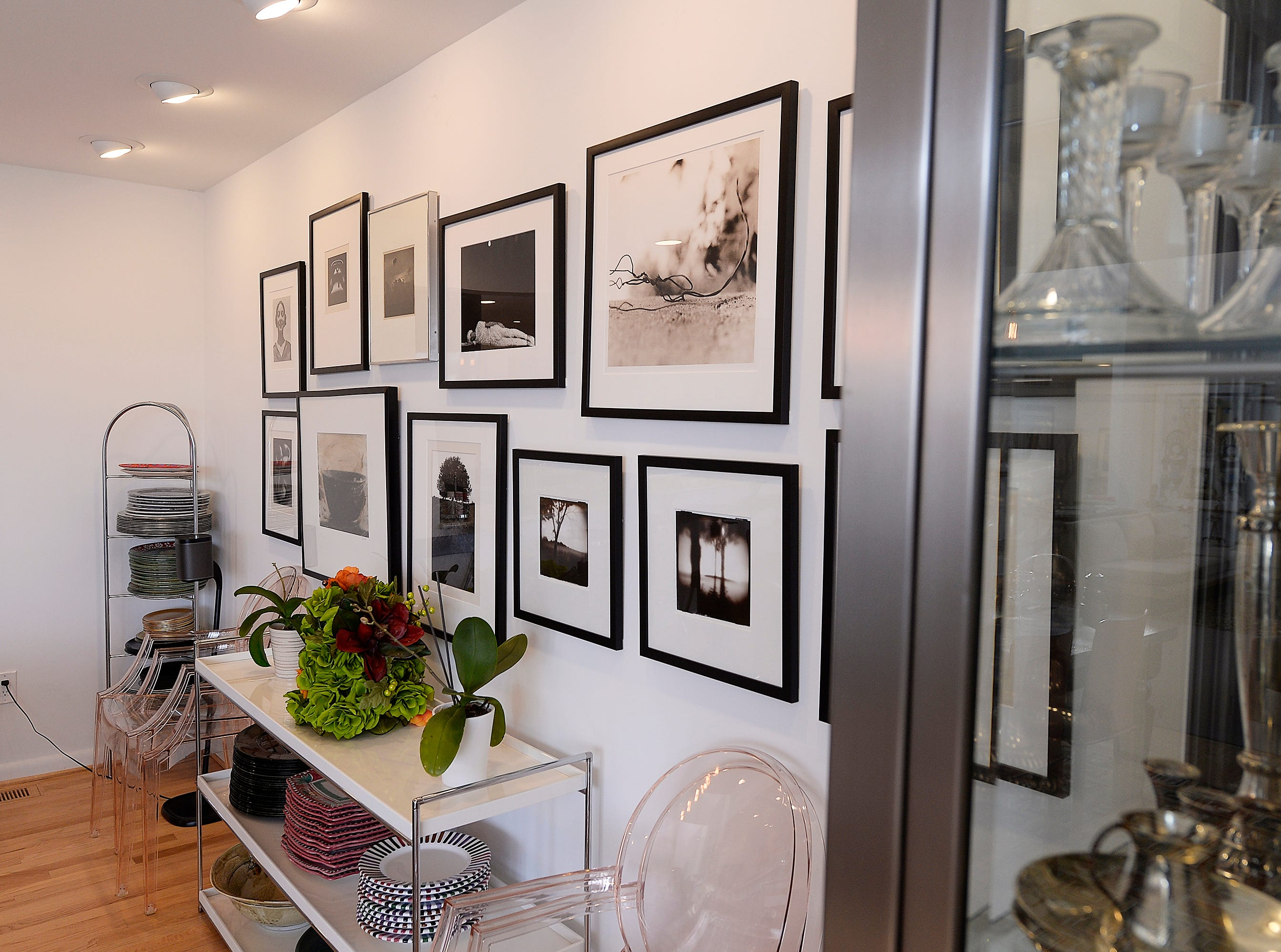 A black & white photo gallery is displayed on the back wall in the dining room.