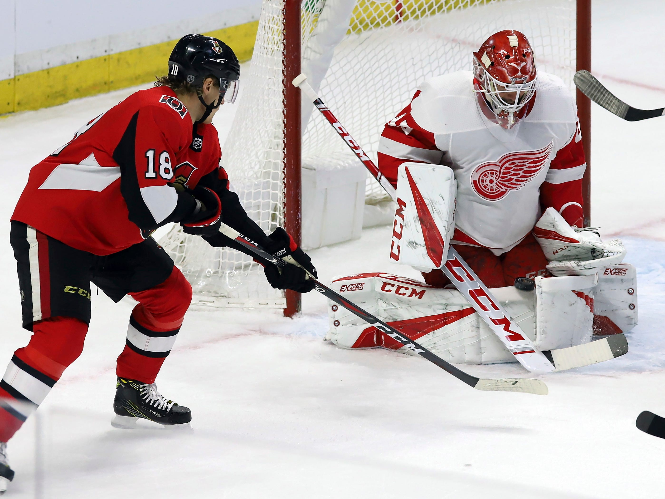Detroit Red Wings goaltender Jonathan Bernier (45) makes a pad-save on a shot by Ottawa Senators' Ryan Dzingel (18) during the third period.