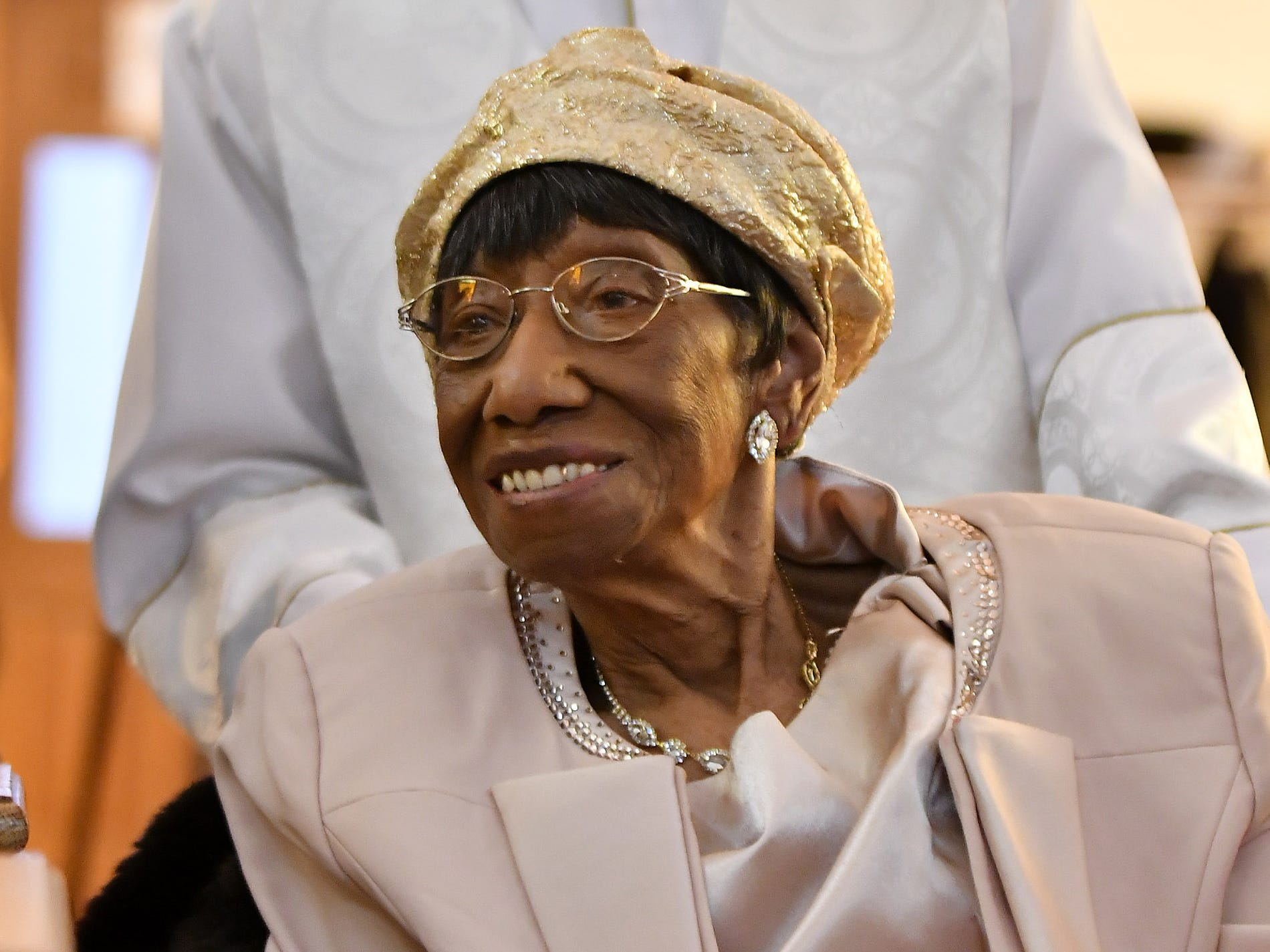 """The Rev. Earnest O. King Sr. stands behind """"Mother"""" Lois Holden while her niece speaks about her at Mount Calvary Baptist Church in Detroit Sunday, during her 109th birthday celebration."""