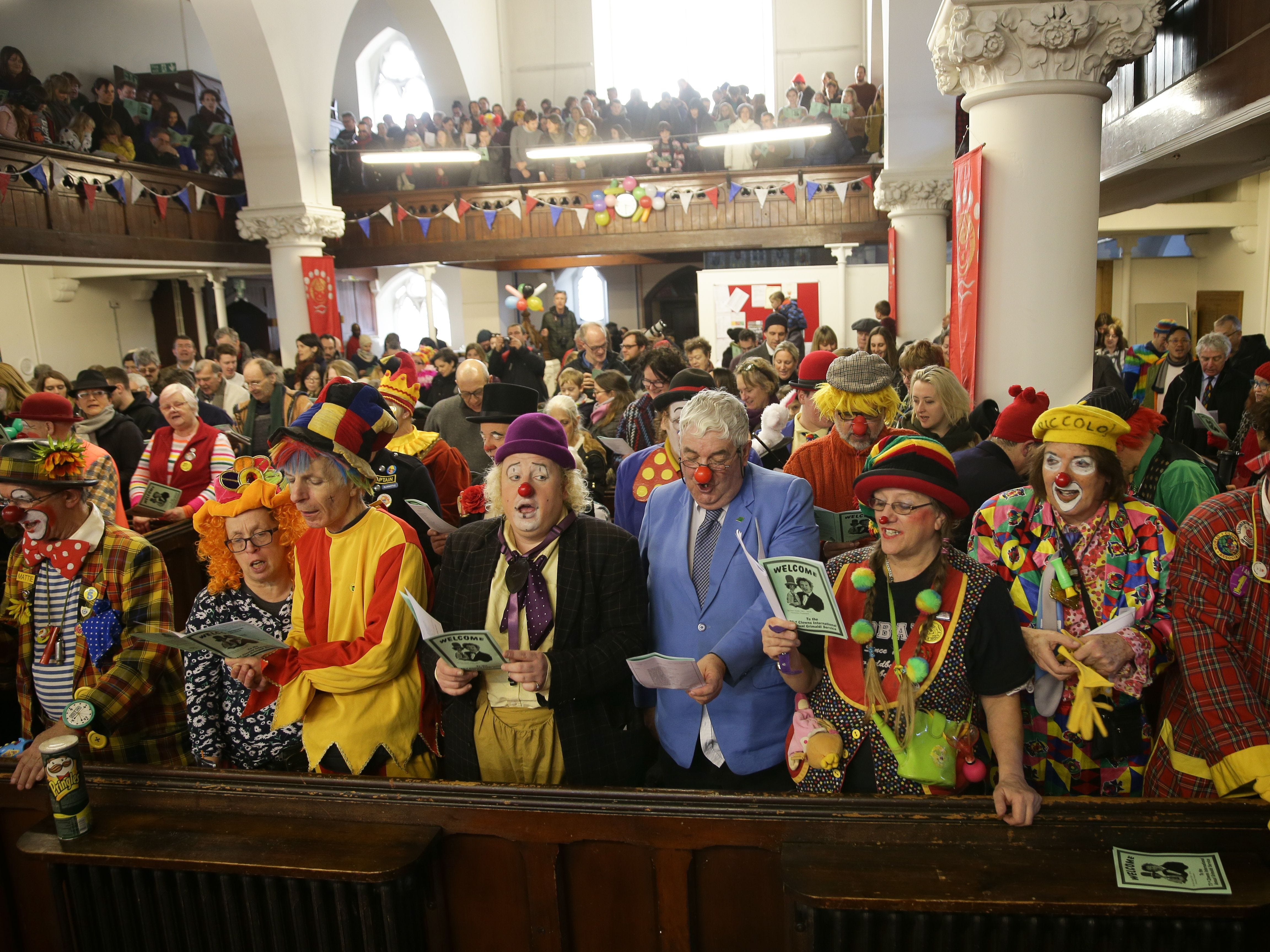 """Clowns attend the 73rd annual Grimaldi Memorial Service at the All Saints church in east London on February 3, 2019. Clowns from across the world gathered for the annual memorial of the legendary Joseph Grimaldi. """"King of clowns"""" Grimaldi was a 19th century English stage performer, and is recognized as having invented the look that came to define the role of a clown."""