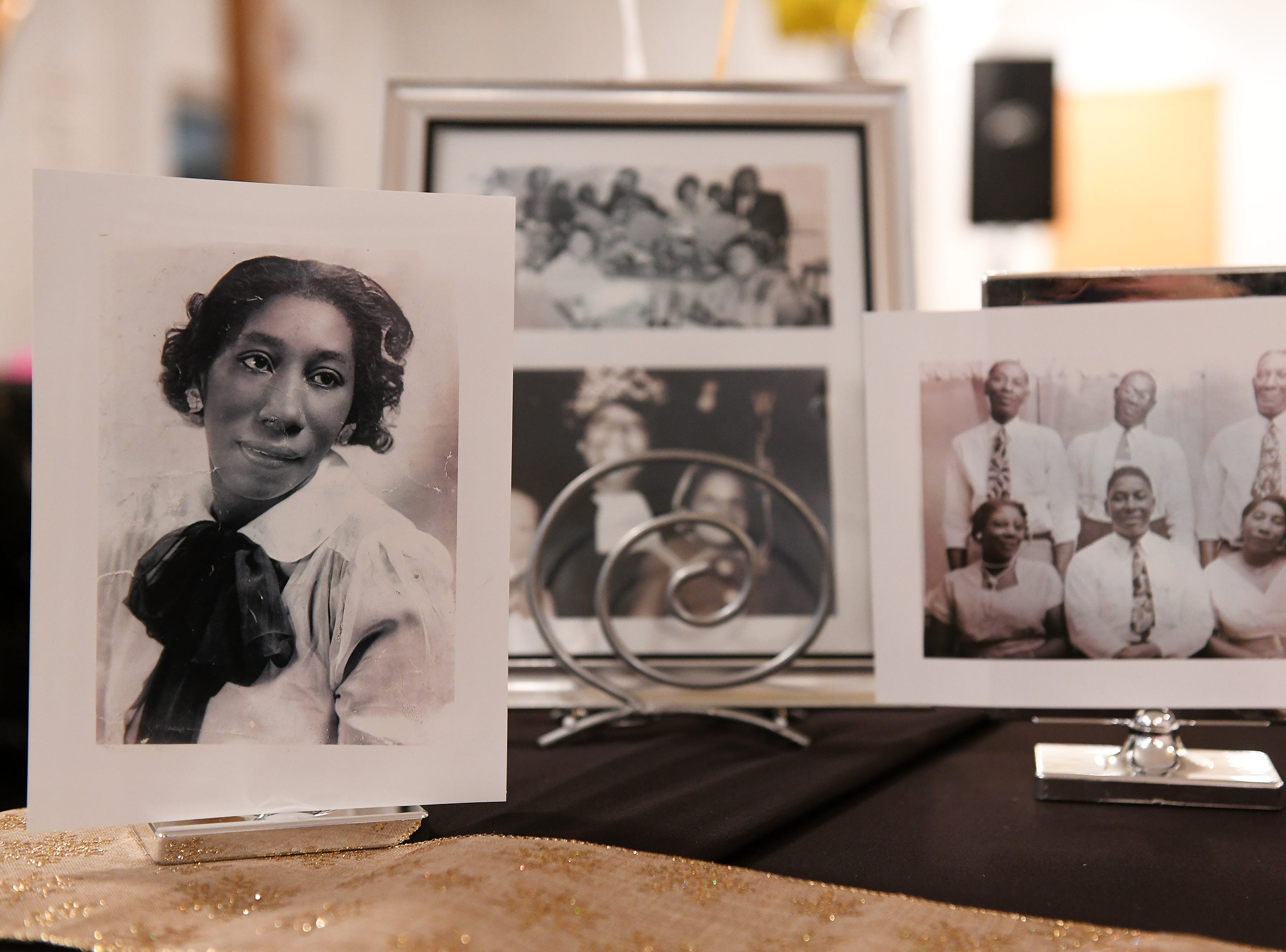 """Some family photos of """"Mother"""" Lois Holden are on display at Mount Calvary Baptist Church in Detroit on Sunday."""