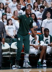 Michigan State's Joshua Langford cheers on teammates against Indiana during the first half Saturday. Indiana won 79-75 in overtime.