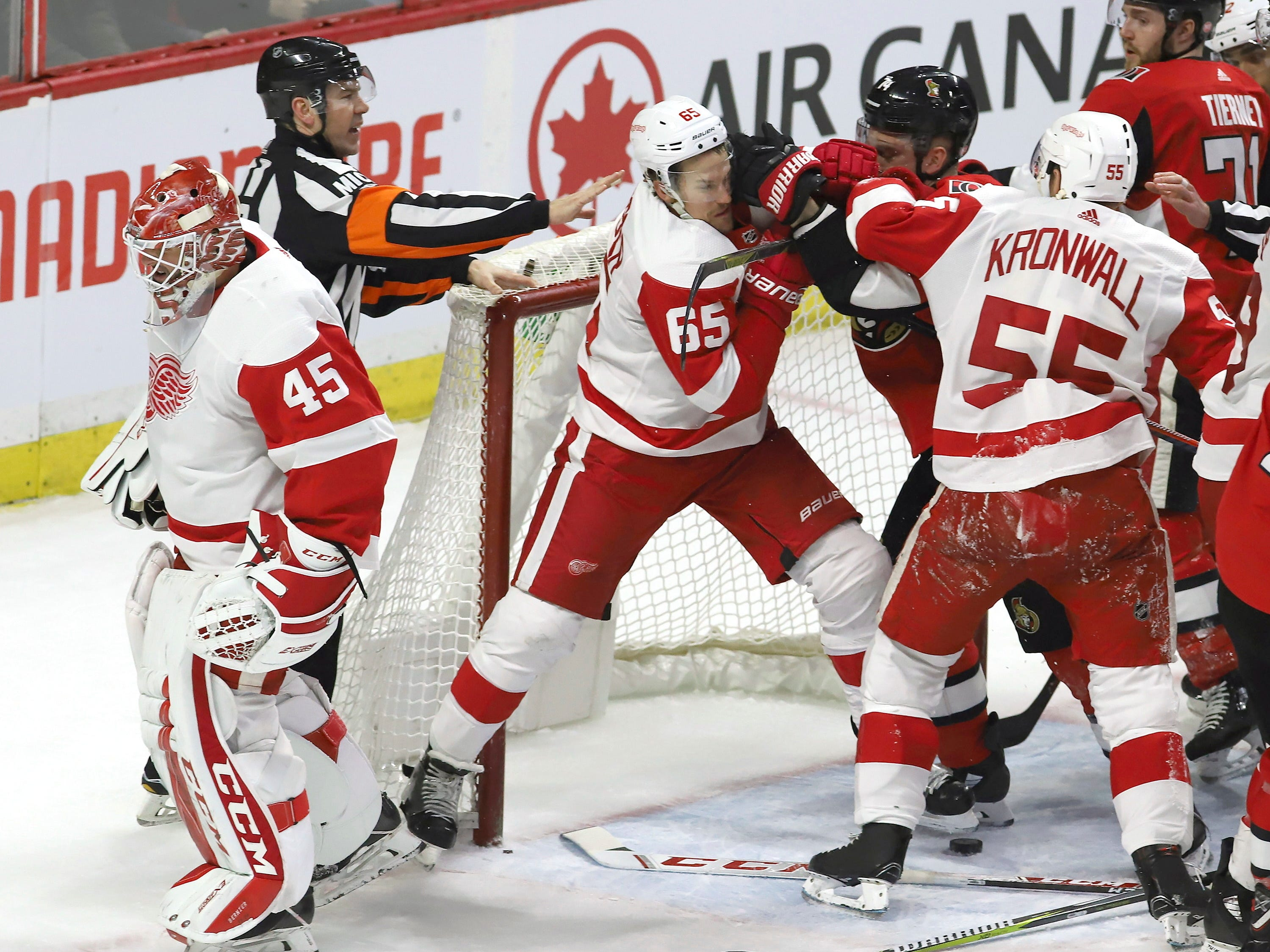 Detroit Red Wings goaltender Jonathan Bernier (45) skates away from a skirmish in front of his net between teammate Danny DeKeyser (65) and Ottawa Senators' Mark Borowiecki (74) during the third period.